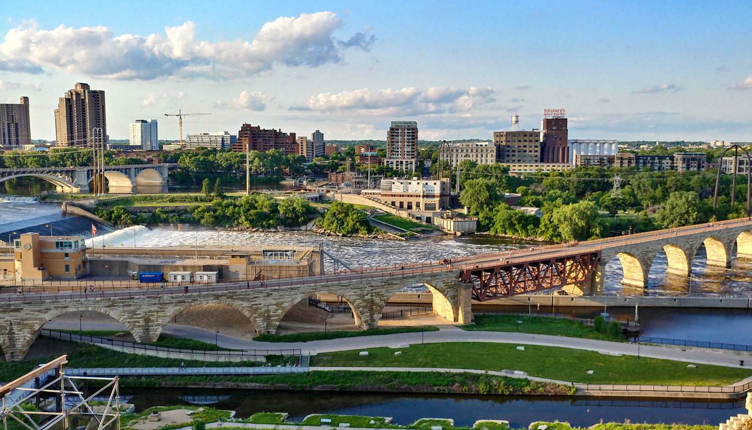 Skyline view of the Stone Arch Bridge in Minneapolis, MN, crossing over the Mississippi River.